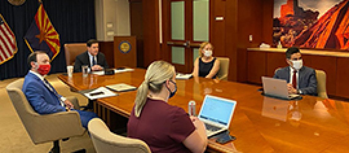 Arizona Gov. Doug Ducey, at head of table, during a videoconference Wednesday with school superintendents about restarting classes this fall. (Photo courtesy Office of Gov. Doug Ducey)